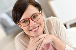 Close of Smiling Brunette Lady with Red Glasses