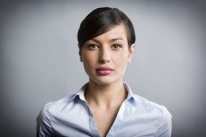 Serious Female Headshot in Business Shirt
