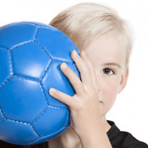 Small Young Boy Holding Blue Soccer Ball to Face